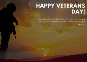 Military person with the sunset in the background and the words Happy Veterans Day